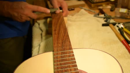 Luthier working on a guitar