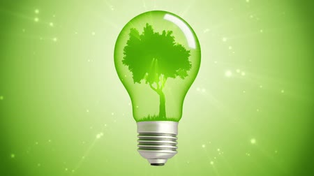 energia : green Tree Inside A Bulb Lamp with falling leaves on grass seamless loop