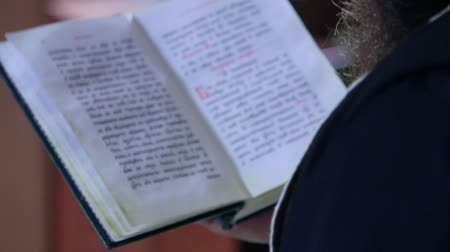 holy scripture : The priest reads the prayer Stock Footage