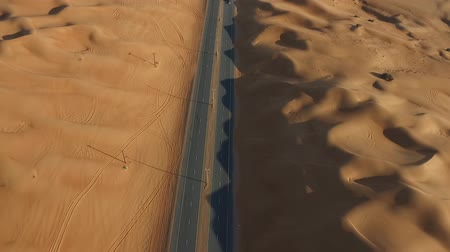toll : Long shot of a desert highway in the United Arab Emirates