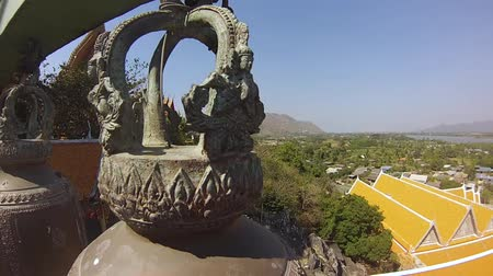 The bells in the temple of the Buddha in Thailand. Circling the camera next to the bell