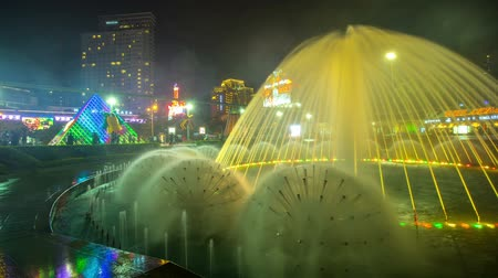 Fountains in China in the city glow at night