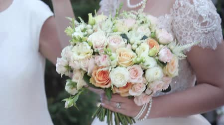 Flowers at the brides hands on the wedding day Stock Footage