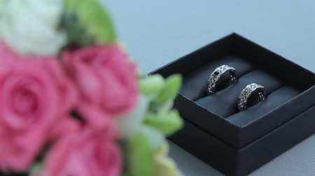 Wedding rings in the box. White gold. Camera moving