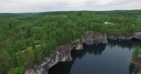 aerial lake mirror with white cliff steep forestry bank Stock Footage