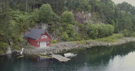 beautiful view small country house with pier on fjord shore Stock Footage