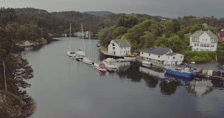 small vessels : aerial view houses on fjord coast with yachts boats at piers
