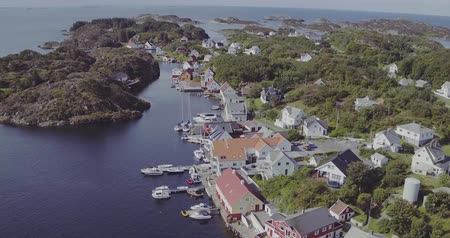 aerial accumulation of islands with houses among sea bay Stock Footage