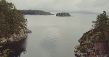 small vessels : flight from fjord neck out to sea with forestry islands