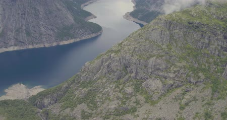 north bay : aerial winding fjord between mountains covered with clouds Stock Footage