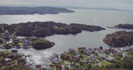 norveç : aerial village on fjord coasts boundless bay on sunny day