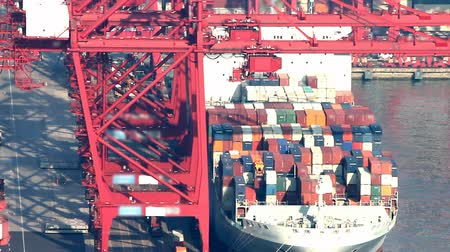 Timelapse video of a cargo ship loading in a cargo port