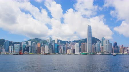 urban skyline : 4k timelapse video of Victoria Harbour in Hong Kong in daytime Stock Footage