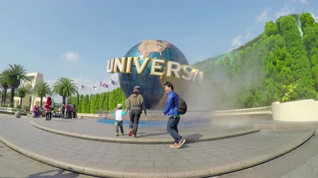 japan : 4k video of people taking photos outside the Universal Studios theme park