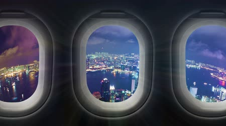 samolot : Timelapse video of city at night through airplane window Wideo