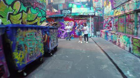 gençlik kültürü : Melbourne, Australia - May 18, 2015: 4k video of walking along the Hosier Lane in Melbourne, Australia. The laneway is a popular travel destination in Melbourne well-known for its urban art Stok Video