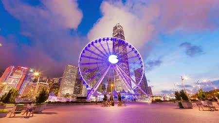 tourism : Hong Kong, China - May 30, 2015: 4k hyperlapse video of skycrapers and Hong Kong Observation Wheel, which is the latest tourist attraction in the city.