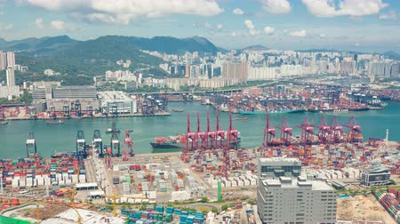 importação : Hong Kong, China - Jun 15, 2015: 4k timelapse video tracking a container ship arriving at the container terminal in Hong Kong Vídeos