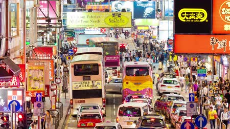 kerület : Hong Kong, China - Jun 2, 2015: 4k timelapse video of pedestrians and traffic in a busy street in Mongkok, which is a popular travel destination in Hong Kong.
