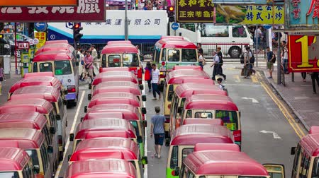 mongkok : Hong Kong, China - Jun 2, 2015: 4k timelapse video of minibuses lining up, waiting for passengers at a busy station in Mongkok, Hong Kong