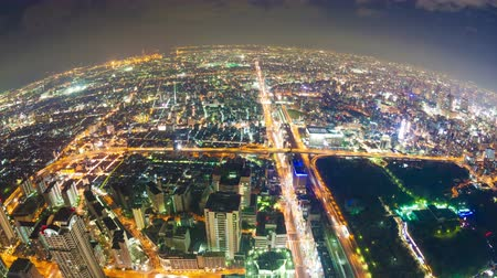 urban skyline : Timelapse video of Osaka in Japan at night, aerial view