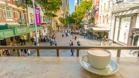 xícara de café : Brisbane, Australia - Sep 26, 2016: 4k timelapse video of enjoying coffee in the Queen Street Mall in Brisbane, Australia Stock Footage