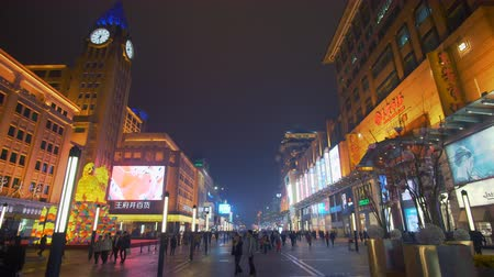 night life : Beijing, China - Mar 17, 2018: 4k panning shot of people at the Wangfujing shopping street in Beijing Stock Footage