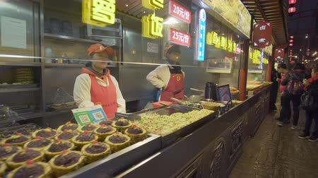 peking : Beijing, China - Mar 17, 2018: 4k video of Wangfujing Snack Street in Beijing