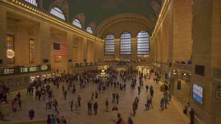 concourse : New York, USA - May 10, 2018: 4k moving shot of commuters at Grand Central Station in New York Stock Footage