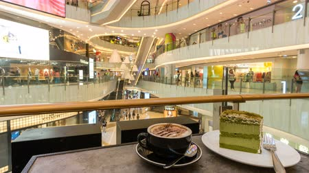 cup : Hong Kong, China - Jun 2, 2017: 4k timelapse video of enjoying coffee and cake in a shopping mall