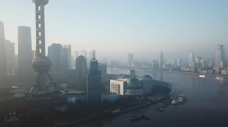 voar : Shanghai, China - Nov 2, 2017: Aerial video of Pudong and The Bund in Shanghai