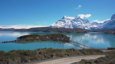 4k panning shot of mountains and lake in Torres del Paine National Park in Chile