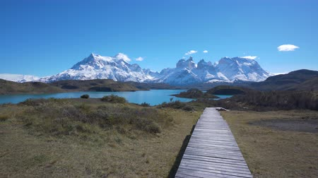 Патагония : 4k moving shot of walking along a boardwalk in Torres del Paine National Park in Chile