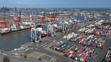 container terminal : Melbourne, Australia - Nov 25, 2018: 4k aerial video of the Port of Melbourne container terminal. It is Australias busiest cargo port Stock Footage