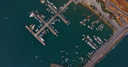 Aerial view of harbour with yachts, sailing boats and small water crafts, small port in Mediterranean, near Cefalu, Sicily . Dostupné videozáznamy