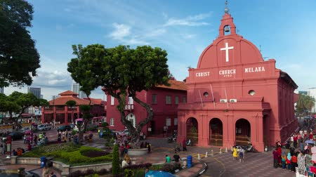 terracota : MELAKA, MALAYSIA - SEPTEMBER 14, 2016: Time lapse of Christ Church located at Dutch Square, Melaka, distinguished by bright, terracotta-red colonial Dutch buildings, built between year 1660 and 1700.