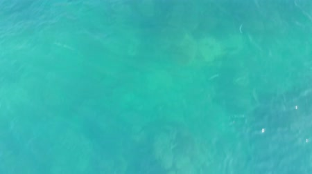 Flight over blue clear water