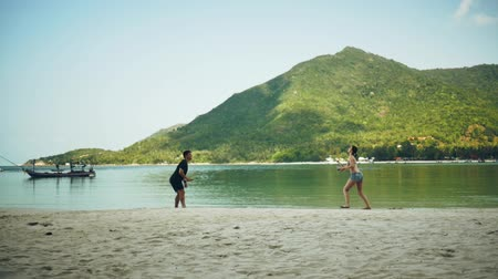 Boy and girl playing on the beach against the background of mountains Dostupné videozáznamy