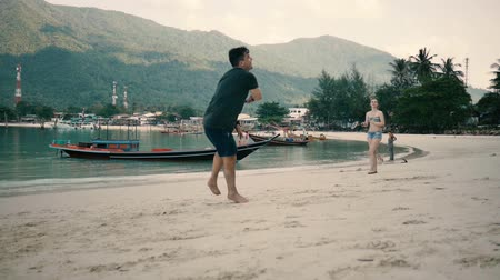 Duo playing on the beach in badminton