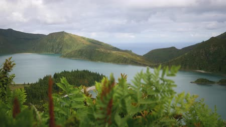 feiticeiro : view of a mountain lake in the crater of an extinct volcano of thick green Stock Footage