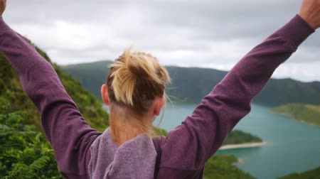 sportsman girl rejoices in the victory and raises her hands up running along the mountain path Dostupné videozáznamy
