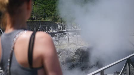 girl on the background of thermal springs