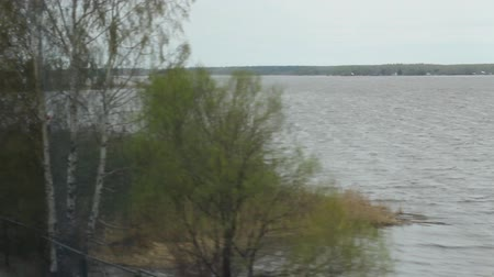 ekspres : Lake view from the window of high-speed train