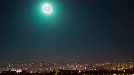 starlit : Moon over city, time lapse