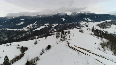 морозный : Small village in the winter mountains. Taken with drone camera. Стоковые видеозаписи