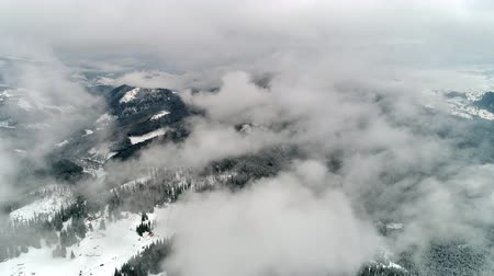 Beautiful mountain day, fly over cloudy winter land