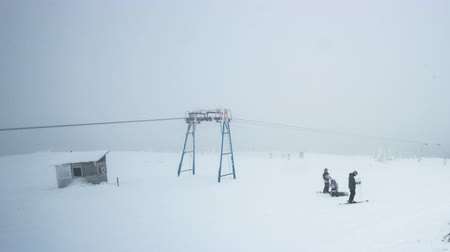 Mountain lift with skiers