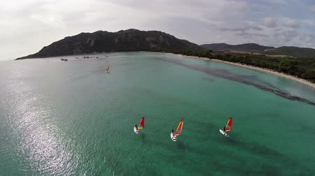 havai : Flight over sea bay with surfers in France, Corsica, Santa Giulia beach. Aerial panoramic view.