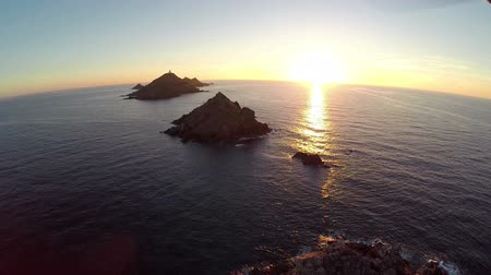 takeoff area : Flight over the sea and islands at sunset, Ajaccio area, Corsica, France. Aerial panoramic view.