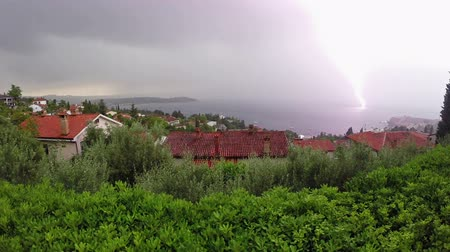 çatırtı : Lightning and thunderstorm above sea bay in daylight, panoramic view.